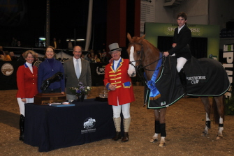 Judgement ISF Perpetual Trophy for the Animal Planet Sporthorse Cup : Beezie Madden, Mary Alice Malone presenting trophy to winning horse. Jumper horse sculpture serving as perpetual trophy