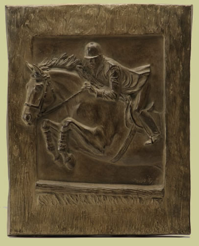 Bronze relief of horse jumping over fence